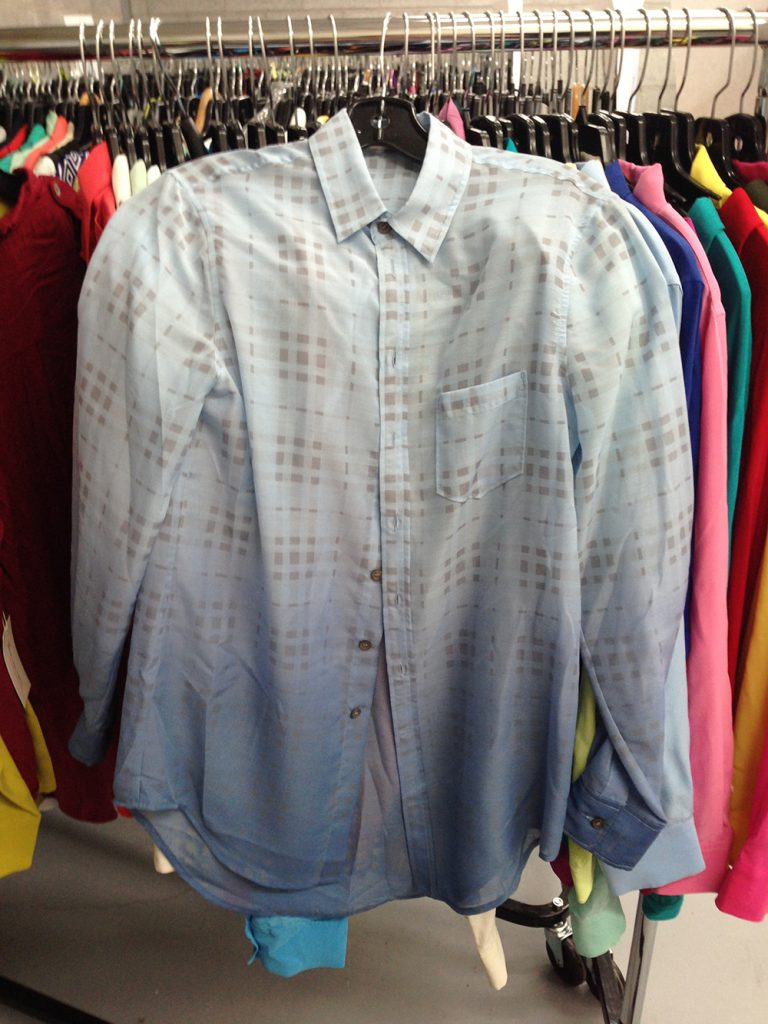 White and blue blouse at $60.